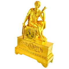 French Empire Figurative Gilt Bronze Clock of a Roman Youth Holding a Scroll