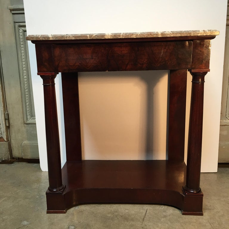 A French Empire style mahogany console with marble top.