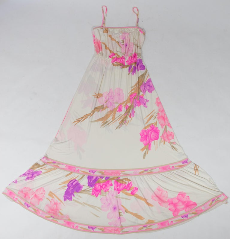 Circa 2000  France  Beautiful romantic summer dress in printed silk jersey by Léonard dating from the 2000s. Long dress with a large bare back neckline, held by two thin straps with press studs. Blousanton effect thanks to an elastic waistband and