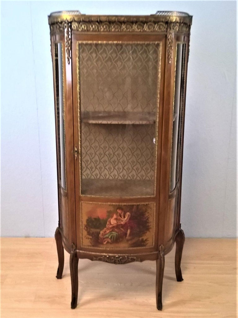 A French Louis XV Revival mahogany vitrine with metal mounts and hand painted scenes