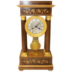 French Marquetry and Ormolu Mounted 14 Day Striking Portico Clock, circa 1830