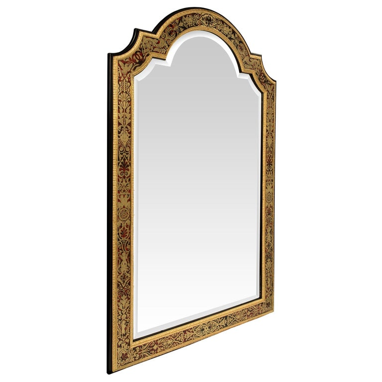 A spectacular and most impressive large scale French mid-19th century Louis XIV style boulle mirror. The original beveled mirror plate is within a frame that features tortoiseshell, brass, ormolu and ebony. The exquisite large scale mirror has a