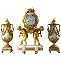 French Ormolu and White Marble Three-Piece Clock Set