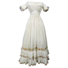 A French Regency Dress in cotton muslin embroidered with wool Circa 1825