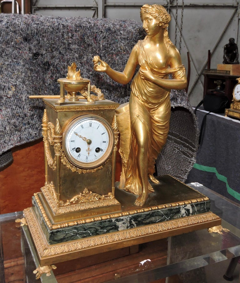 Gilt French Restauration Marble and Ormolu Mantle Clock For Sale