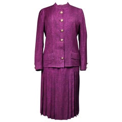 A FrenchCouture Chanel Skirt and Jacket Suit numbered 60423 and 60422 Circa 1970