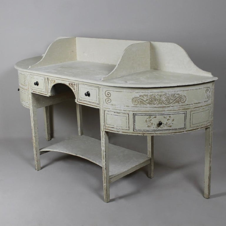 A truly wonderful, George III, country house, dressing table or double washstand. Dry scraped back to its original paint and decoration, standing on elegant tapered legs and with four drawers, English, circa 1780.