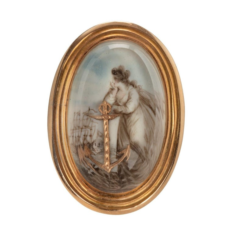 A large George III glazed gold, enamel and ivory ring representing the figure of Hope with her anchor, gazing out to sea and a squadron of warships. English, circa 1800  Usually portrayed with her anchor attribute, the figure of Hope, one of the