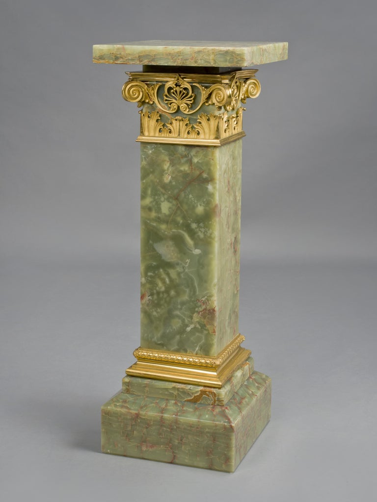 A fine gilt-bronze mounted dark green onyx pedestal with a revolving top.