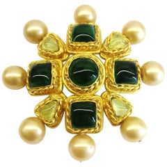A gilt metal, poured glass 'cruxiform' brooch, Maison Goossens for Chanel, 1986