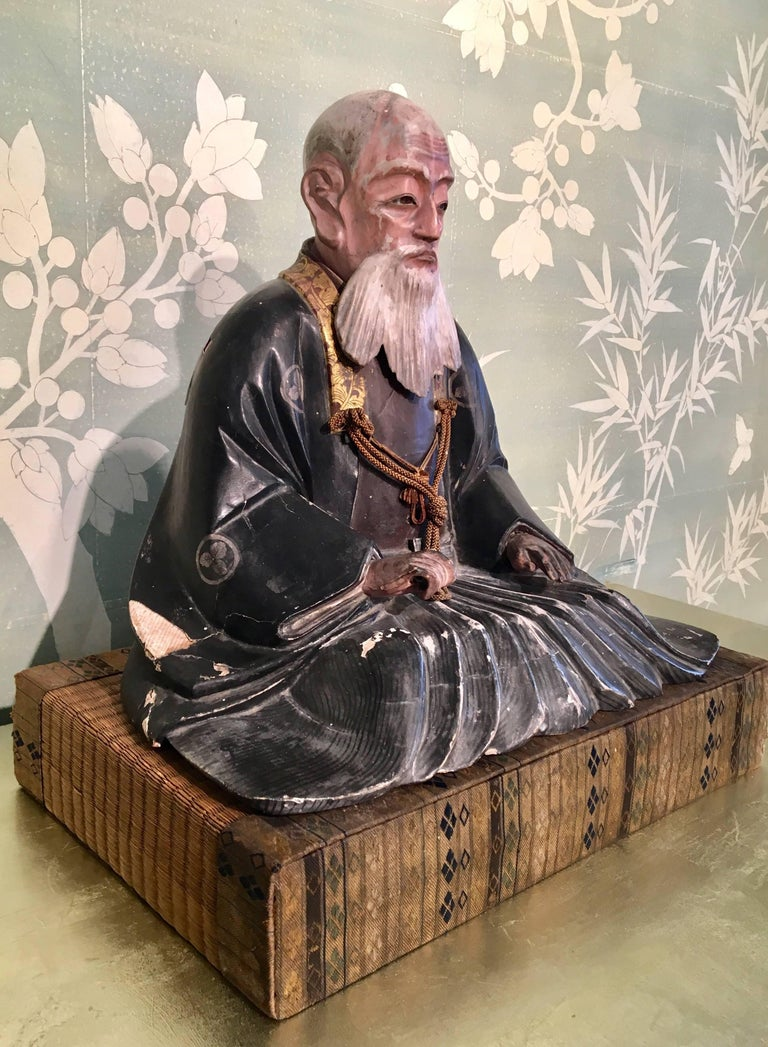A late 18th early 19th century Japanese giltwood carved Noble Elder. Measures: 16.5 inches tall on stand.