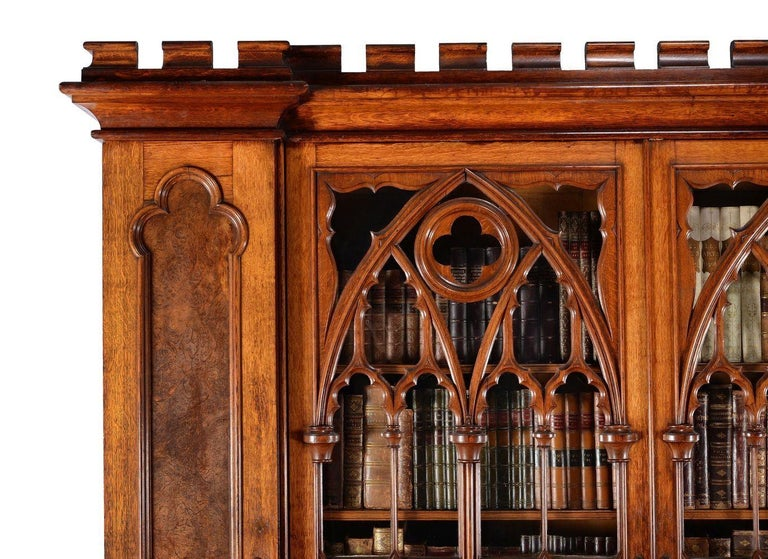 A stunning and magnificent example of a Gothic Revival oak and pollard oak cabinet bookcase, circa 1880, this is an amazing piece and would grace any of the countries cathedrals or stately homes.