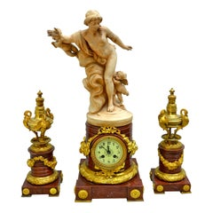 Griotte Marble and Gilt Bronze Clock Garniture with a Terracotta Nymph Statue