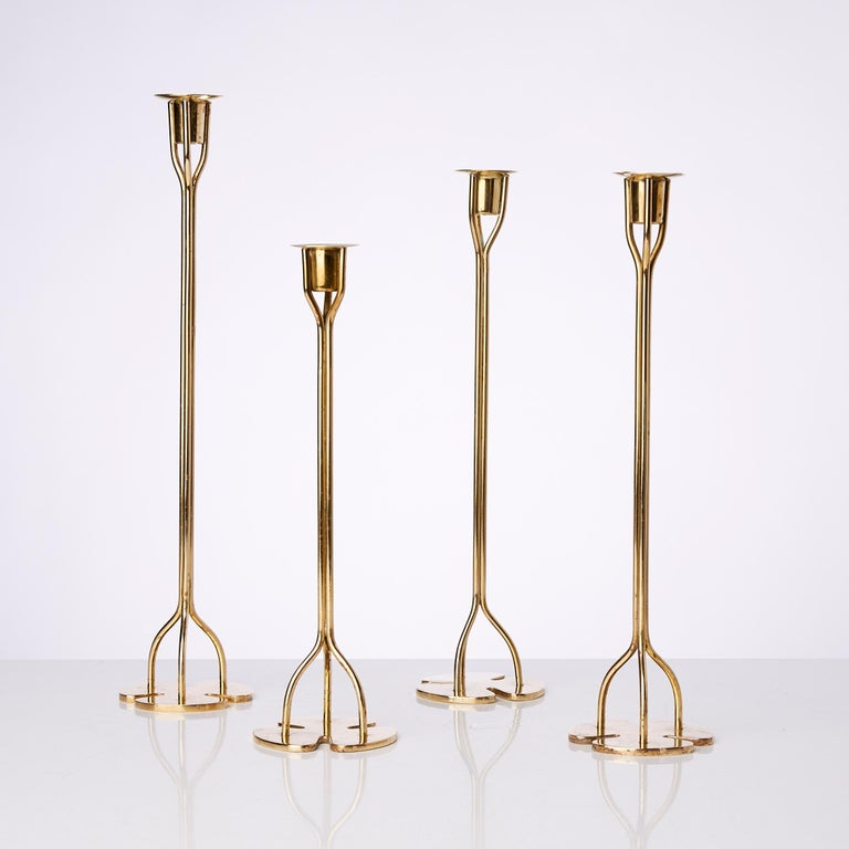 Set of four candleholders, of various heights, each made of three elongated stems. Designed by Austrian-Swedish architect and designer Josef Frank in the 1940s for Svenskt Tenn, Stockholm. These candlesticks are early examples of how nature and