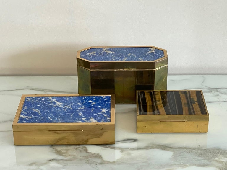 An elegant group of Italian boxes ca' 1970's. Brass, lapis lazuli and tiger's eye.