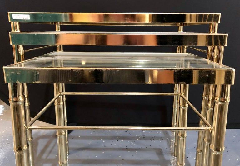 Mid-Century Modern Group of Three Faux Bamboo Brass Nesting Tables with Glass Tops For Sale