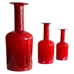 Group of Three Red Otto Bauer Holmegaard Bottles