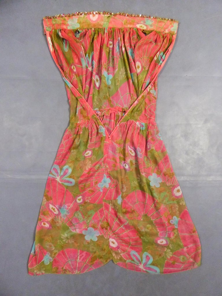 Circa 1965/1970 France  Beautiful evening set made by Guy Laroche in printed silk crepe dating from the years 1965/1970. Sleeveless dress with high mandarincollar and zip in the back, densely embroidered with sequins, pearls and iridescent