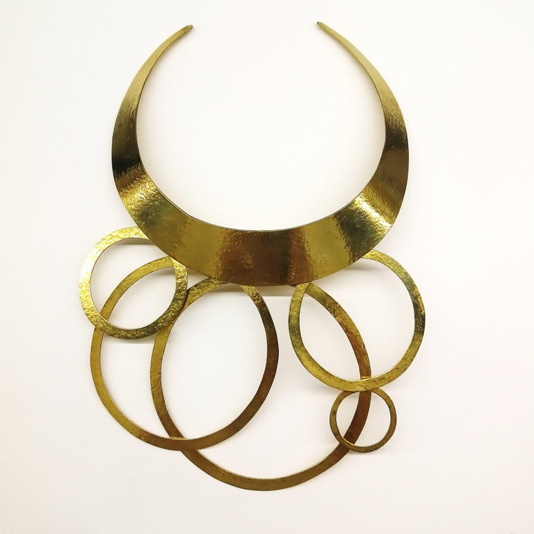 A stunning statement necklace and unique design, sculptural and highly stylised, from Herve Van Der Straeten. Consisting of five variable articulated circles, suspended from a very comfortable torque, it was made in Paris in the 1990s .The necklace