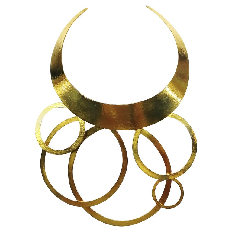 A hammered gold plated metal necklace, Herve Van Der Straeten, France , 1990s. For Sale