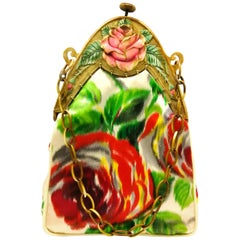 A hand coloured celluloid frame, and silk 'rose' motif handbag, French, 1920s