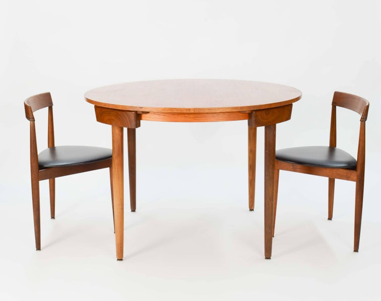 A Hans Olsen Dinette nesting set for Frem Rojle that has two chairs and in a fixed top. The chairs measures 28.5
