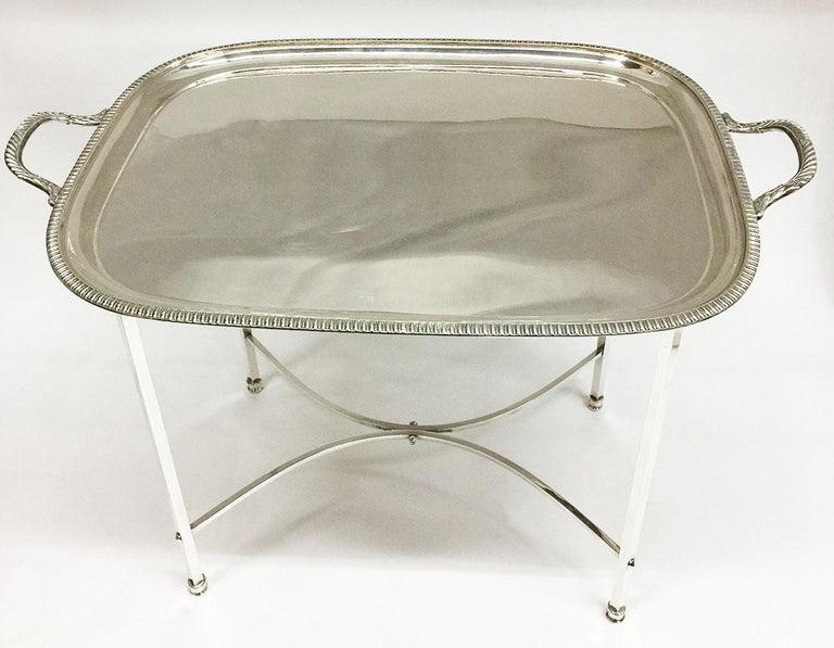 A Harrison Brothers & Howson English silver plated tea table  A Harrison Brothers & Howson English silver plated tea table with tray and Stand The mark HB&H inside a shield of A Harrison Brothers & Howson (1862-1909) in Birmingham The tray with