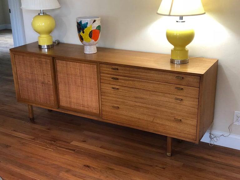A Classic Harvey Probber mahogany credenza with caned panels and drawers. Brass sabots and cork lined drawers are just some of the details that distinguish this unusual piece.