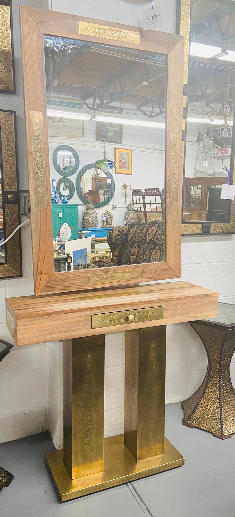 An elegant Hollywood Regency style set of mirror and console. Made of high quality walnut, the mirror and console are decorated with gold brass featuring a fine and elegant filigree design.  This mirror and console will look fabulous in your