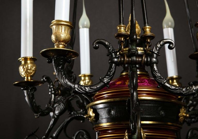 Hollywood Regency Style Gilt Bronze and Red Porcelain Figural Chandelier For Sale 7