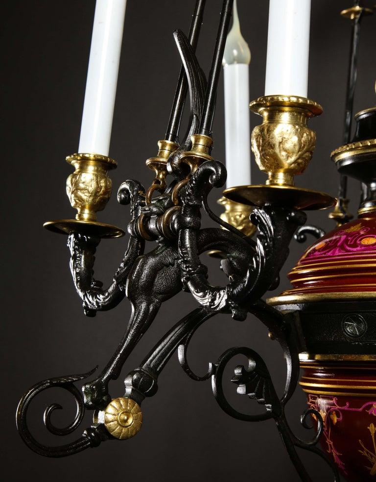 Hollywood Regency Style Gilt Bronze and Red Porcelain Figural Chandelier For Sale 3