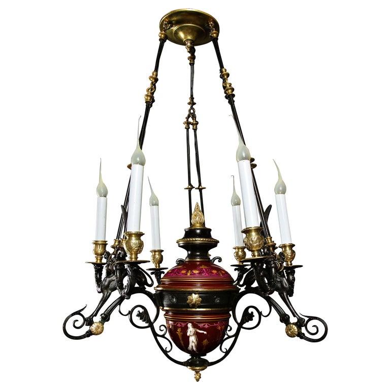 Hollywood Regency Style Gilt Bronze and Red Porcelain Figural Chandelier For Sale