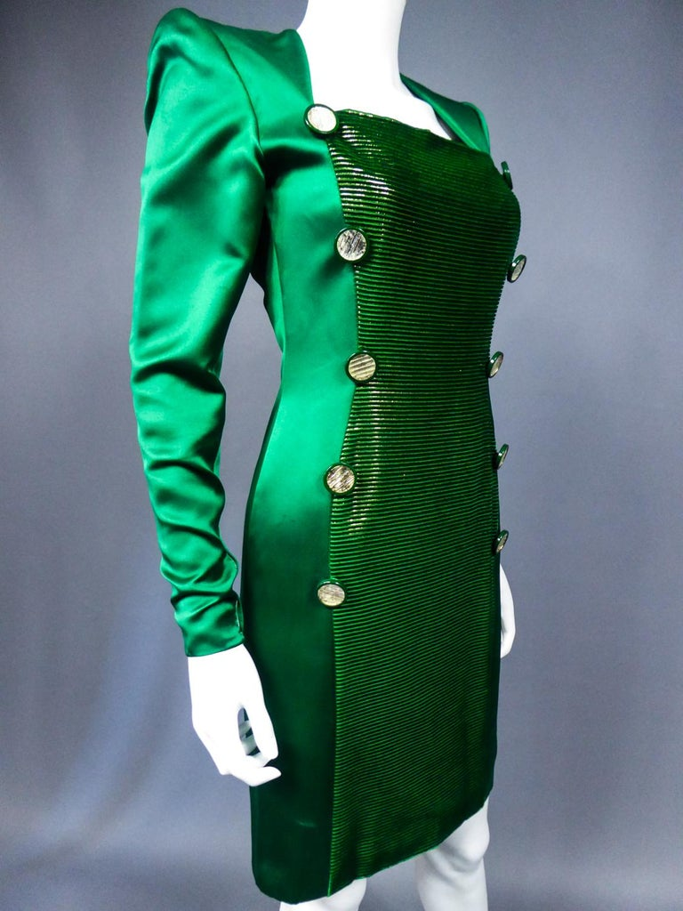 Circa 1985 France Haute Couture  A Hubert de Givenchy dress for showin emerald silk satin and gold lamé velvet dating from 1985/1990. Straight dress slightly skin-tight and long sleeves with huge shoulder-pads. Long dickey inribbed velvet and lamé