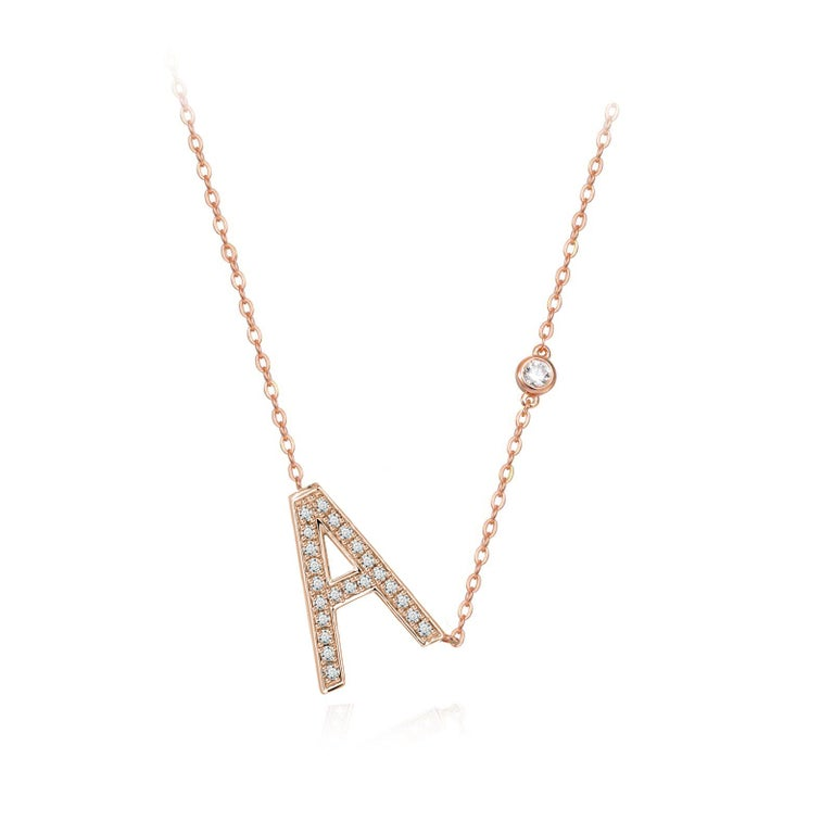 Nothing says YOU more than YOU. You are unique. You are bold. You're not afraid to share who you are. This initial bezel chain necklace is elegantly slimline while sharing a little bit about yourself with others. .925 sterling silver base also