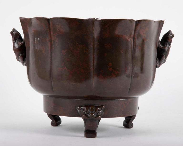 A Japanese Meiji censer rising on three stylized Foo Dogs feet with Frog form handles. Censer having exceptional patination.  Acquired from Michael Goedhuis, London, 19 June 1987 by repute.