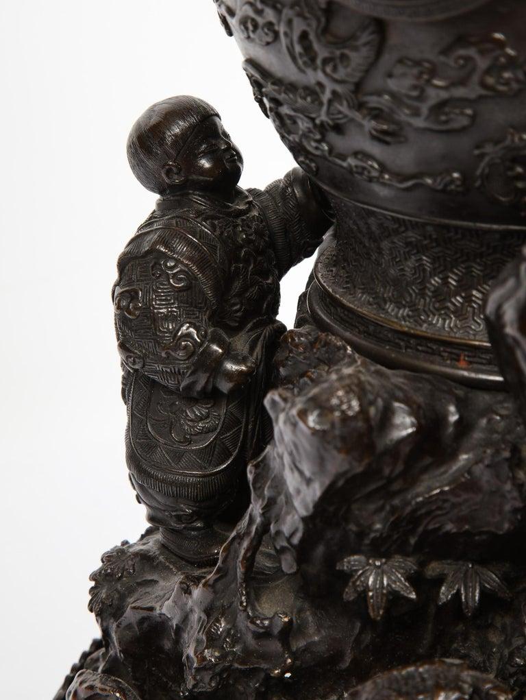 Japanese Patinated Bronze Figural Clock Vase, Meiji Period For Sale 6