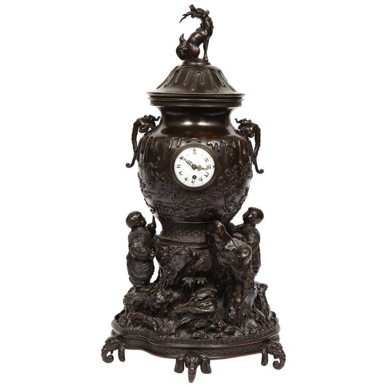 Japanese Patinated Bronze Figural Clock Vase, Meiji Period For Sale