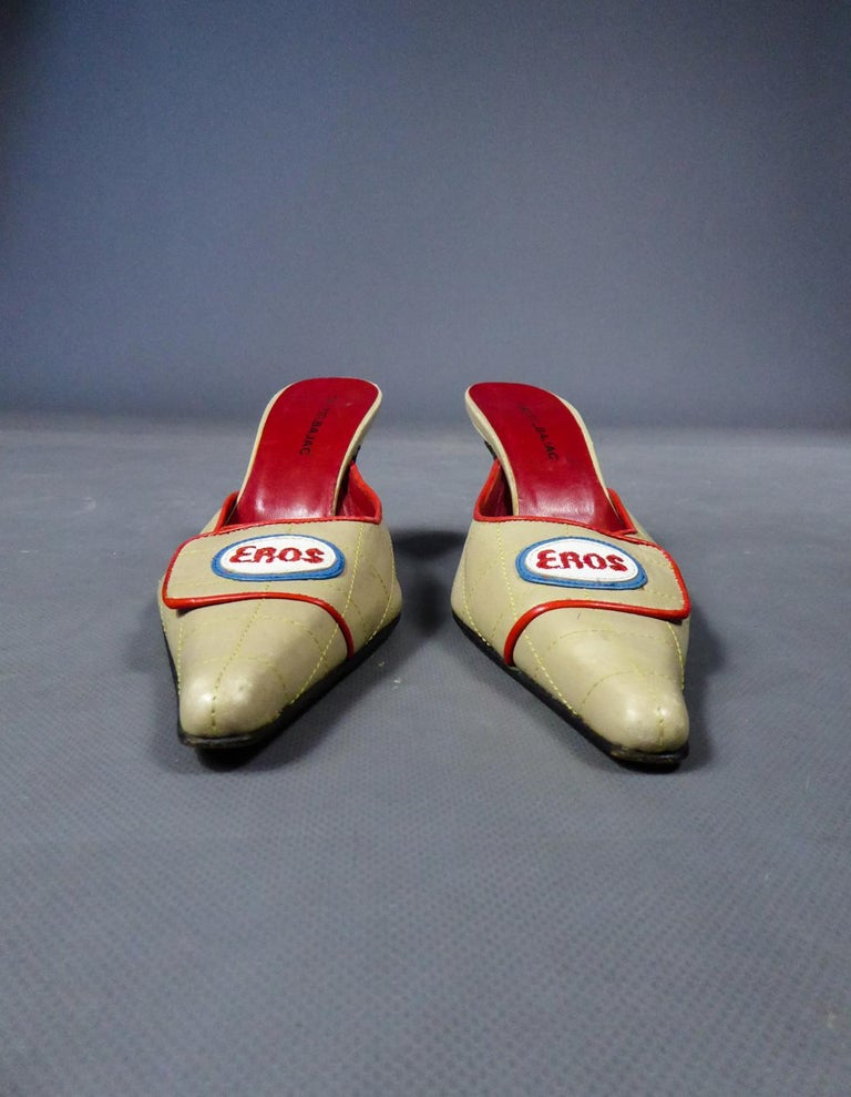 Circa 1990 France  Shoes or pair of mules in beige overstitched leather and signed Castelbajac from the 1990s. Long and pointed tips with flaps surrounded with red leather and adorned with an overstitched and embroidered label in leather indicating