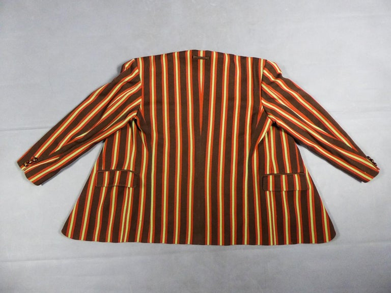 Collection Winter 1992/1993 France  Blazer jacket in wool gabardine from the Jean-Paul Gaultier Men's Collection Les Fous de la Photographie, Winter 1992/1993. Bayadère wool in chocolate, red and anise shades. Notched collar, part of which in ecru