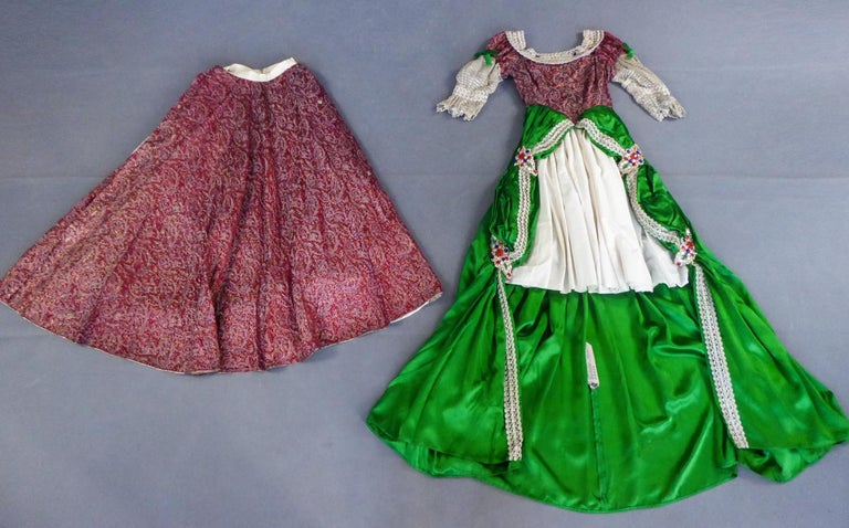 Summer Collection 1939 Paris France   A Fancy or Masquerade historical Court dress in the taste of Louis XIII french style. Mantle-dress and skirt in emerald green satin and carmin and gold lamé brocade with striped paisley boteh motifs. Trimmings