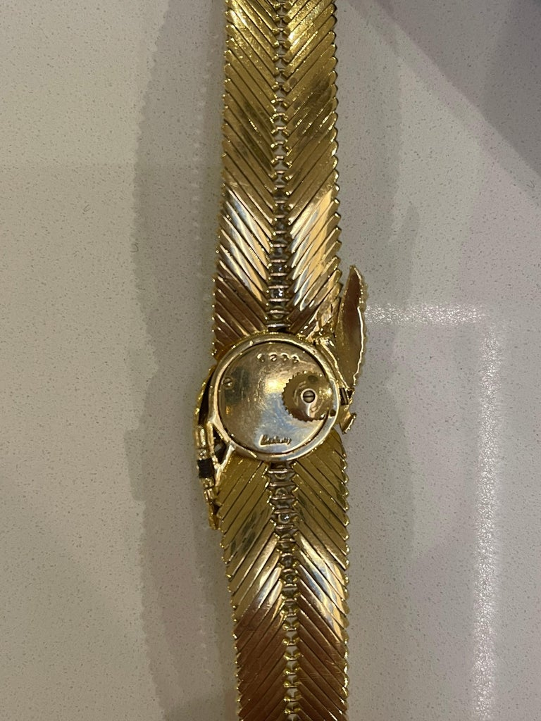 A Kutchinsky 18kt Yellow gold and diamond ladies wristwatch in original leather box. This very stylish watch is set with approximately 4 carats of very white clean diamonds. The watch movement is by Jaeger Le Coultre The watch is signed together
