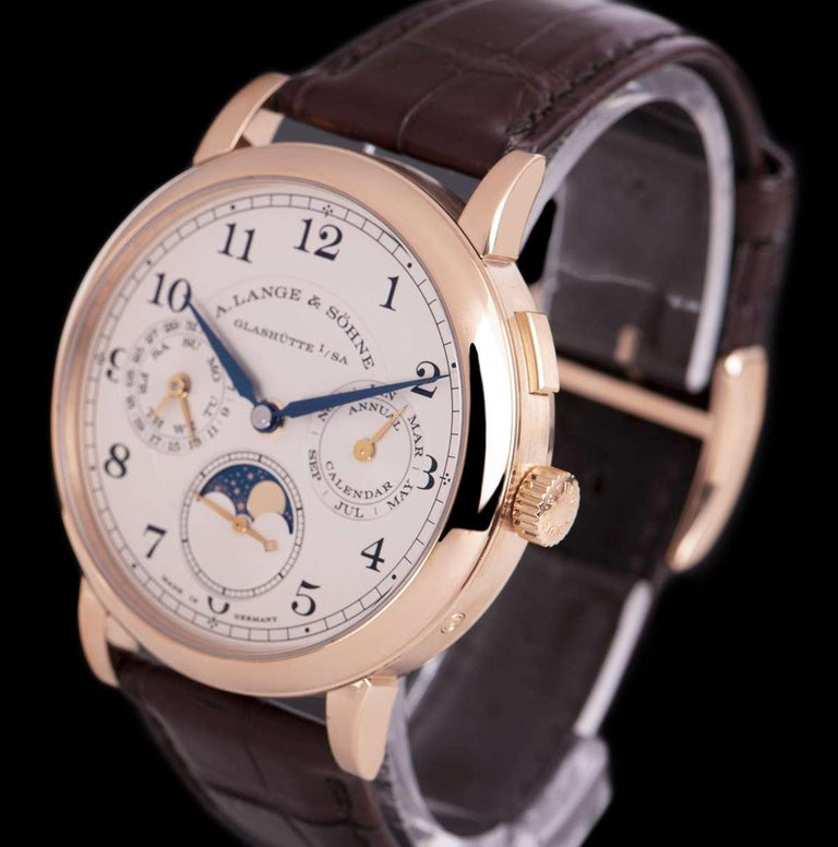 A 40mm 18k Rose Gold 1815 Annual Calendar Gents Wristwatch, silver dial with arabic numbers, month sub-dial at 3 0'clock, moonphase display and small seconds at 6 0'clock, date and weekday sub-dial at 9 0'clock, a fixed 18k rose gold bezel, an