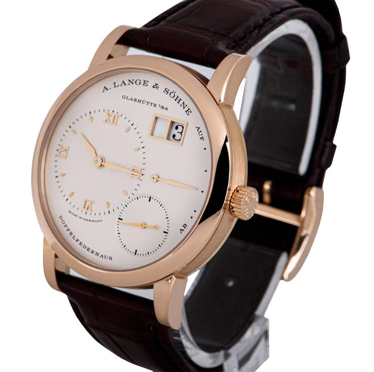 A 38.5 mm 18k Rose Gold Lange 1 Gents Wristwatch, argente silver dial - date at 1 0'clock, power reserve indicator at 3 0'clock, small seconds at 5 0'clock, argente silver off-centred dial at 9 0'clock with applied hour markers and applied roman