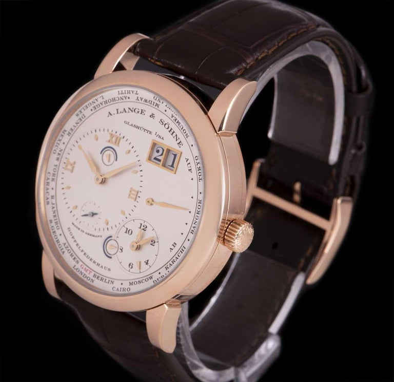 A 41.9 mm 18k Rose Gold Lange 1 Time Zone Gents Wristwatch, silver main dial - date at 1 0'clock, power reserve indicator at 3 0'clock, second time zone at 5 0'clock with day and night indicator, silver off-centred dial with applied hour markers and