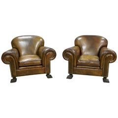 Large and Impressive Pair of Leather Club Chairs with Carved Feet, circa 1930