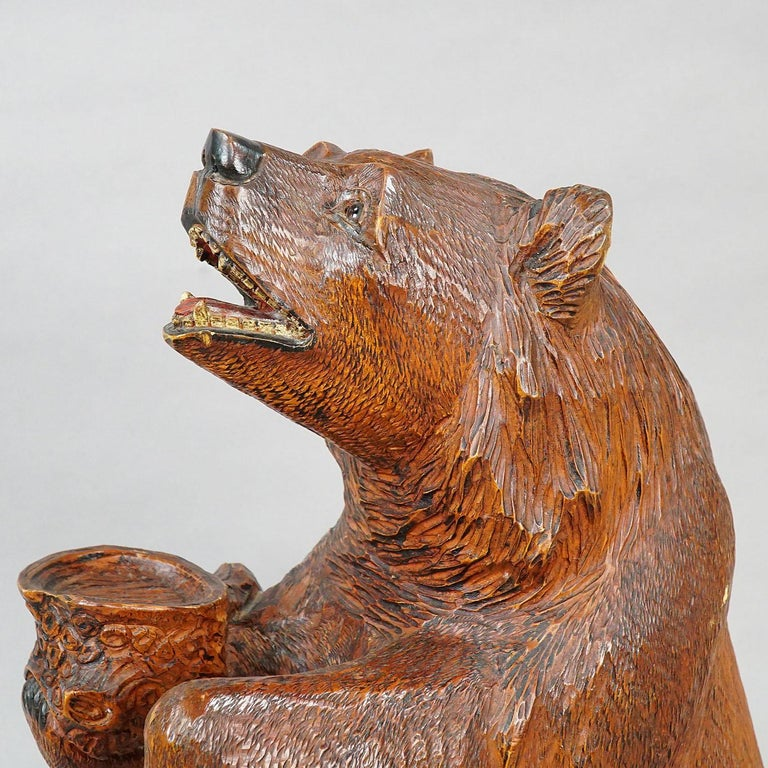 an antique finely carved Black Forest begging bear, brienz, circa 1930.  Measures: width: 7.48