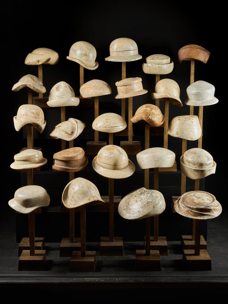 A large collection of 25 wooden hat forming shape models.   Between 43 x 25.5 and 66.5 x 25.