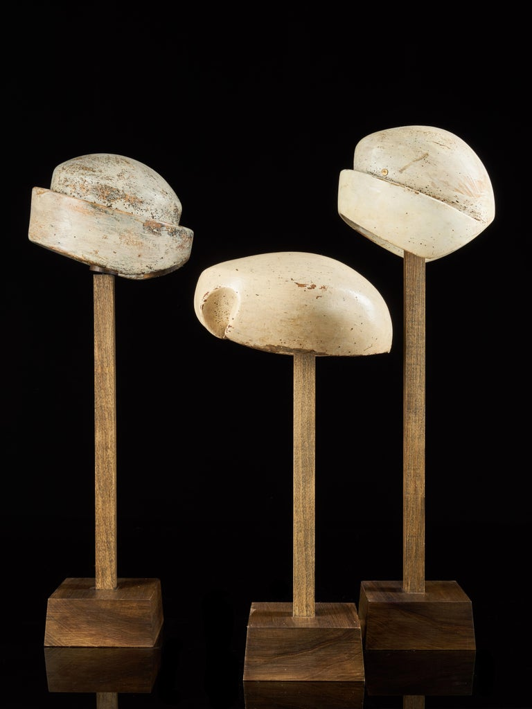 20th Century Large Collection of 25 Wooden Hat Forming Shape Models on Custom Made Stands For Sale