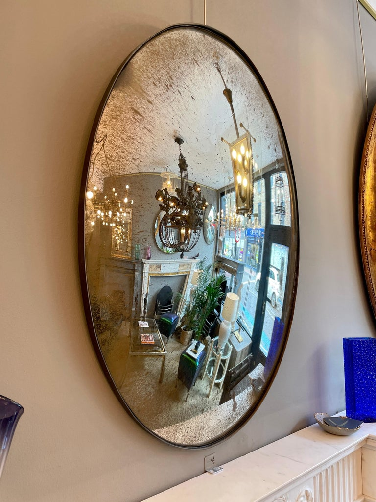 English Large Convex Oval Silver Distressed Mirror For Sale