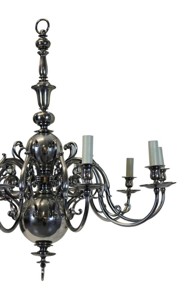 A large English silver plated chandelier with ten scrolled arms, with matching chain and canopy.